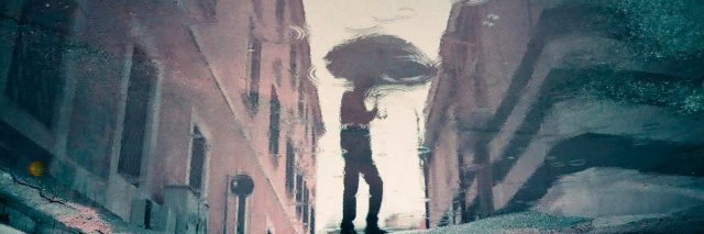 A reflection of a man holding an umbrella