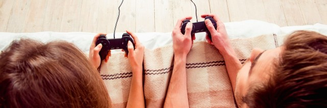 A man and a woman playing video games
