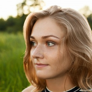 Close-up image of a beutiful girl isolated over green background
