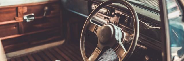 Old rusty steering wheel vehicle car in a vintage style.