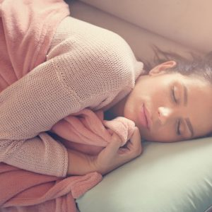 woman sleeping on her couch