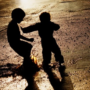 Children pushing in puddle