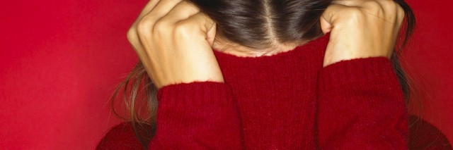Woman hiding in red turtleneck