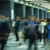 People walking down passage in station, blurred motion, Tokyo, Japan