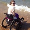 girl in wheelchair at beach
