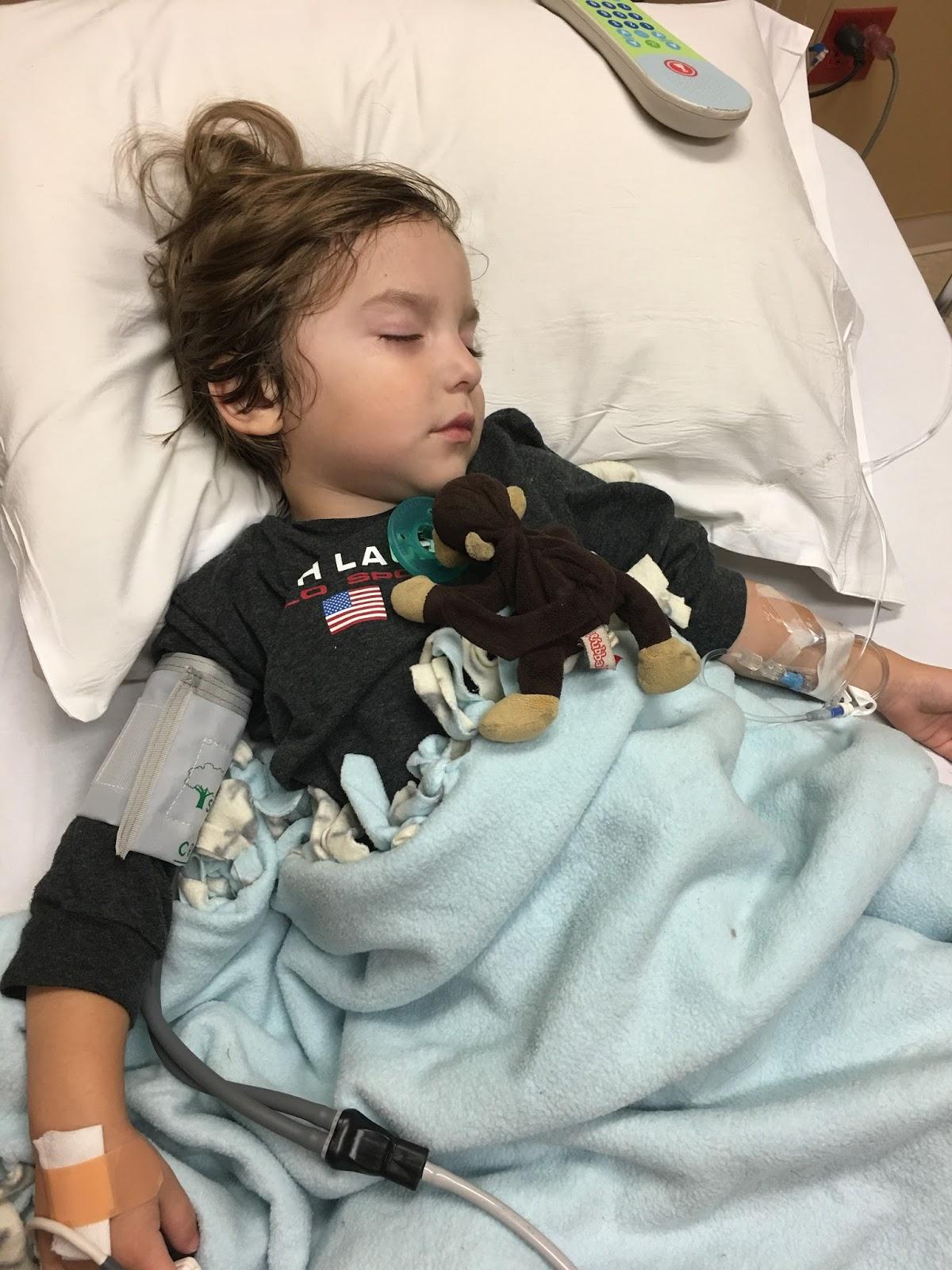 little boy in hospital bed
