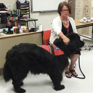 Lesley and her service dog.