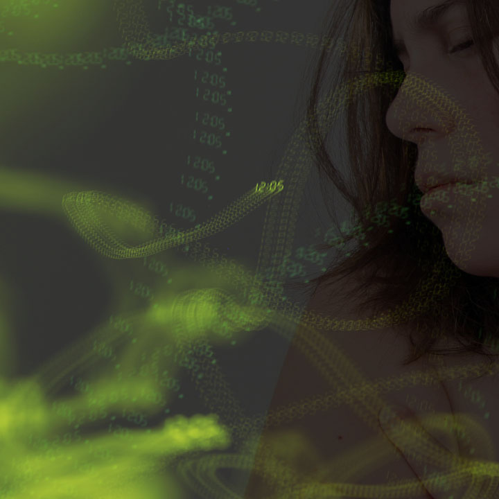 a double exposure image of a side profile of a woman and green lights