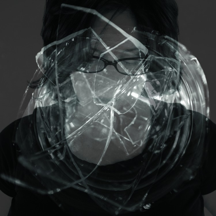 an abstract image of lights and a woman's face