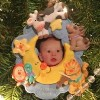 christmas ornament featuring babys photo