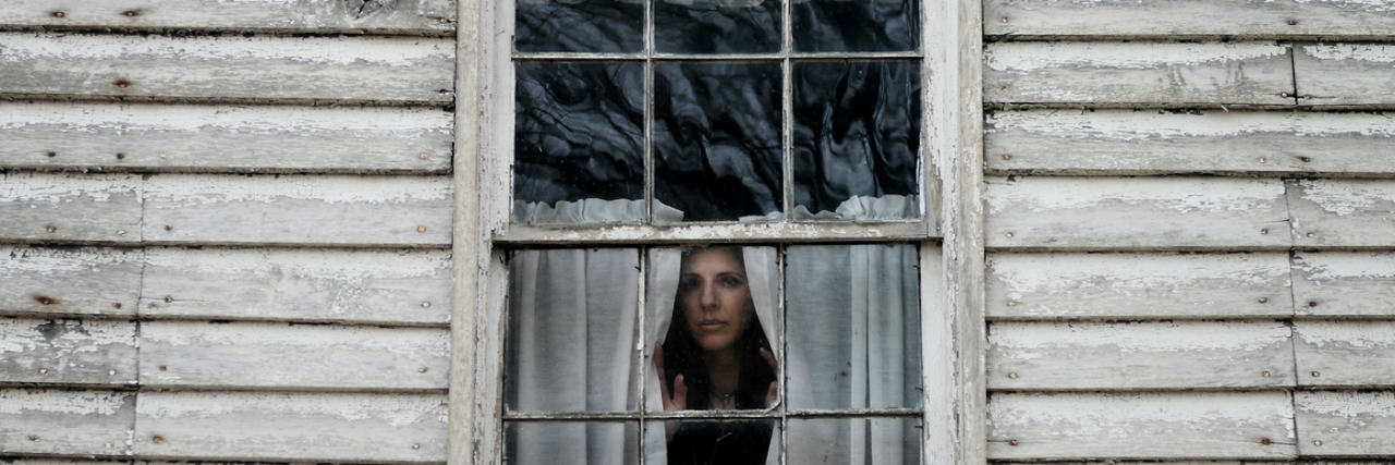 woman looking through a window