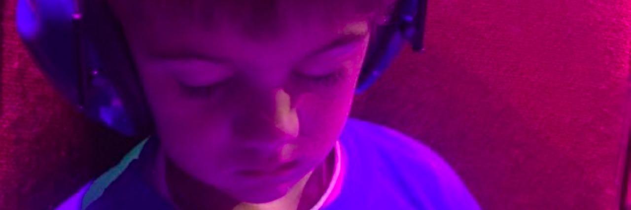 young boy wearing headphones and sleeping