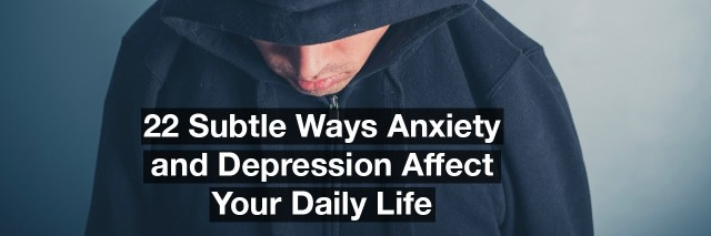 A young man is wearing a hooded top and is looking down. Text reads: 22 subtle ways anxiety and depression affect your daily life.