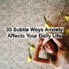 Woman lying with flowers. text reads: 33 subtle ways anxiety affects your daily life