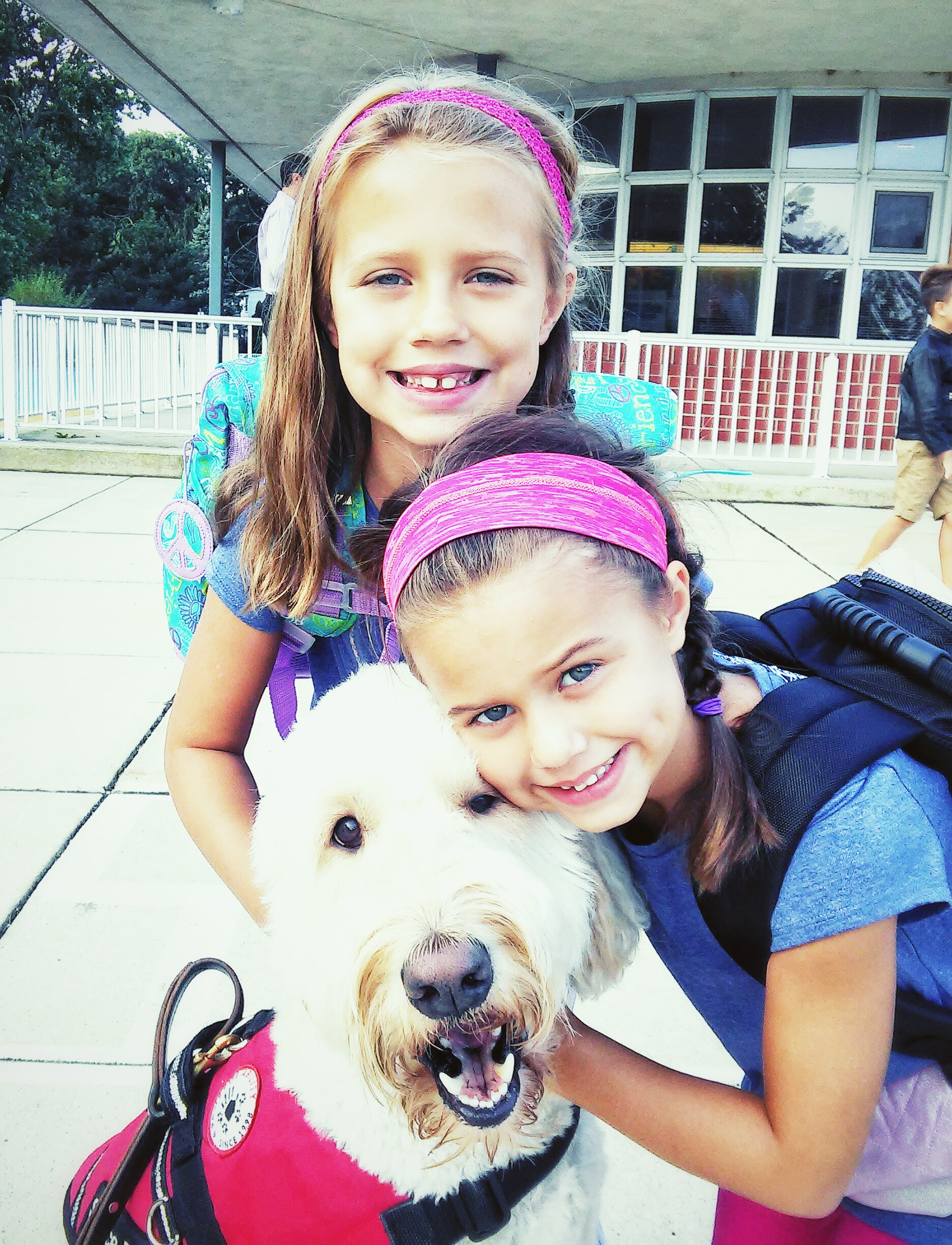 Two girls outside with service dog
