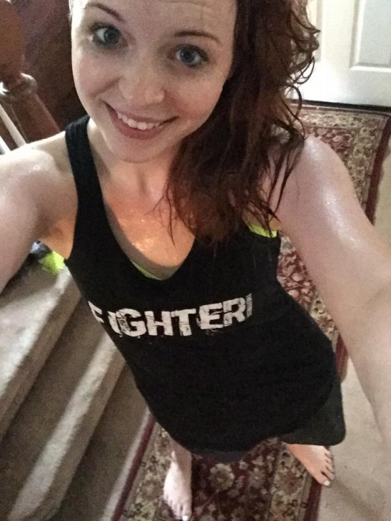 woman wearing tank top that says fighter