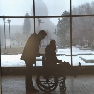 Jenna being pushed in her wheelchair.