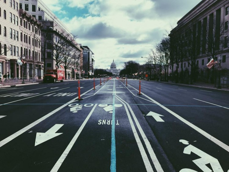 photo of a street leading to the white house