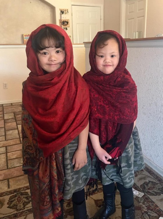 two girls with down syndrome wearing scarves on heads