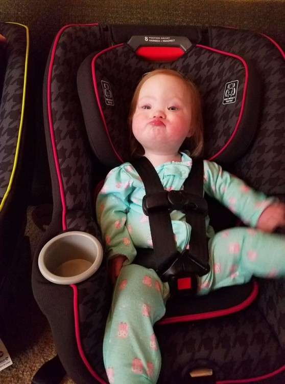 toddler girl with down syndrome in car seat