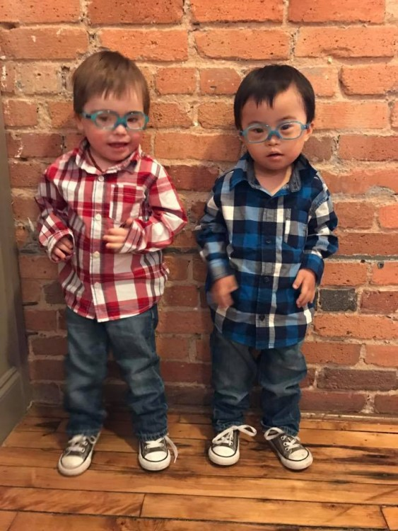 twin boys with down syndrome wearing plaid shirts