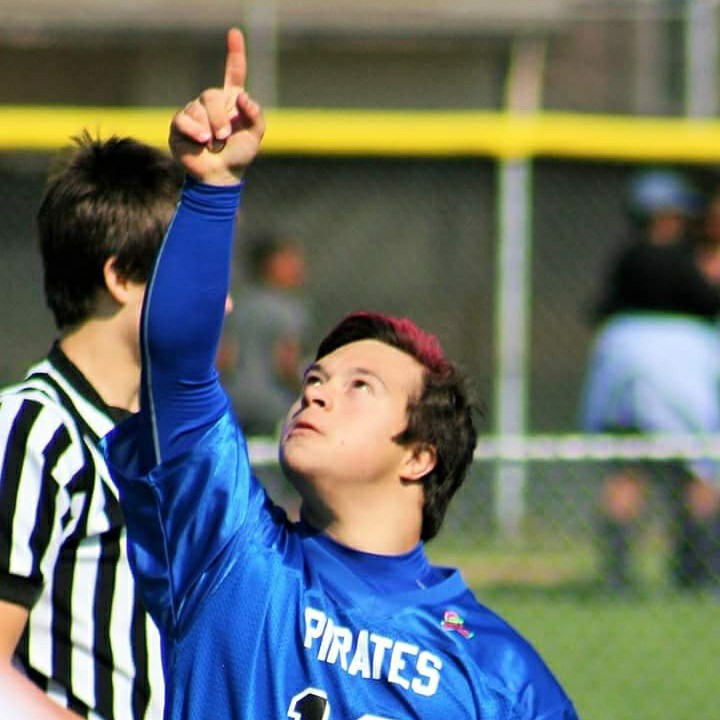 man with down syndrome playing football