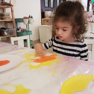 Tala's daughter finger painting at school..