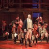 A shot of the musical with Alexander Hamilton at the front and ensemble in the back