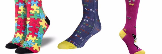 Photo of autism awareness socks featuring puzzle pieces, down syndrome awareness socks and socks with dogs on them.