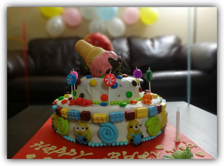 ice-cream-themed cake that says happy bday