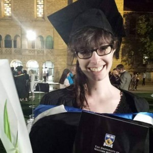 woman wearing cap and gown at her college graduation