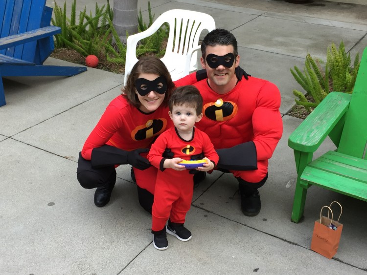 A family of three dressed as the Incredibles.