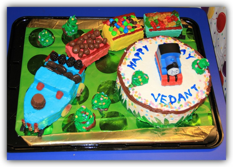 Train cake that says happy bday Vedant