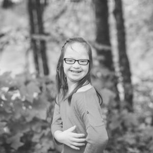 girl smiling in the woods