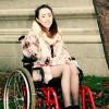 Niamh Herbert in a wheelchair outside.