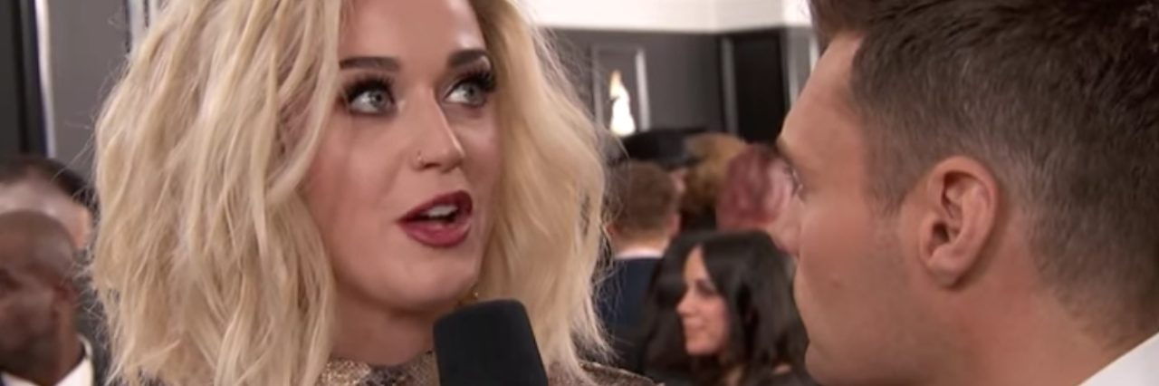 Katy Perry being interviewed by Ryan Seacrest