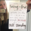 woman holding sign about loving your body