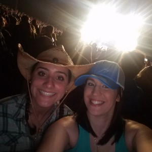 Two friends at a country music concert.