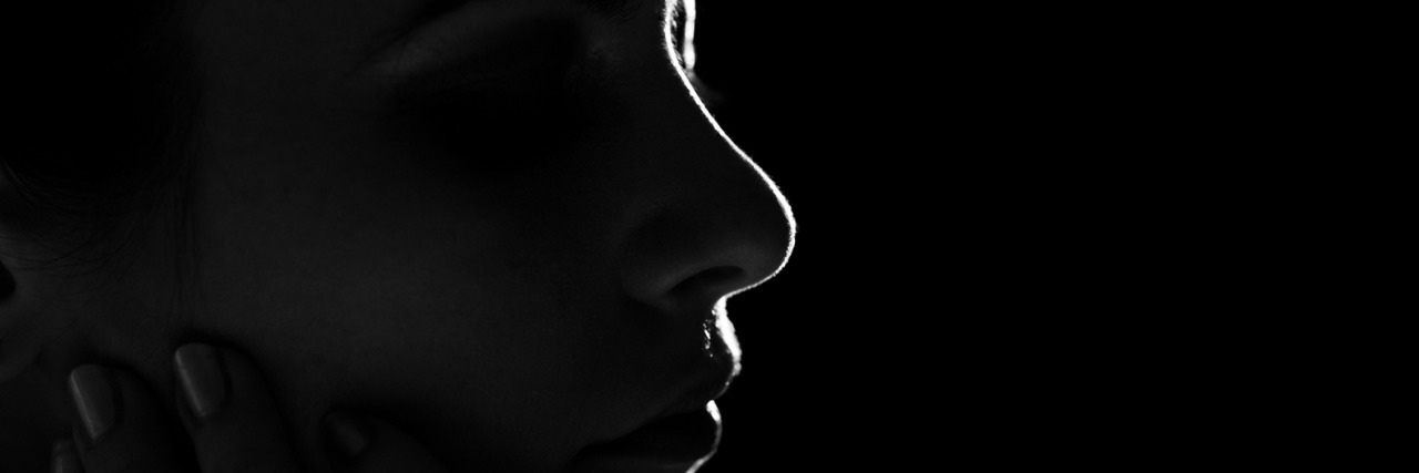 Black and white profile of woman