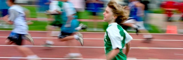 Young boy running on a track