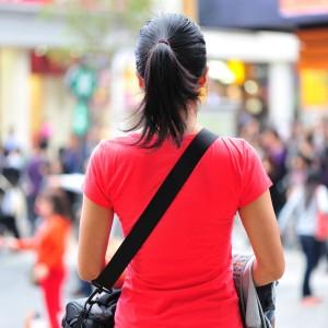 woman facing crowded mall