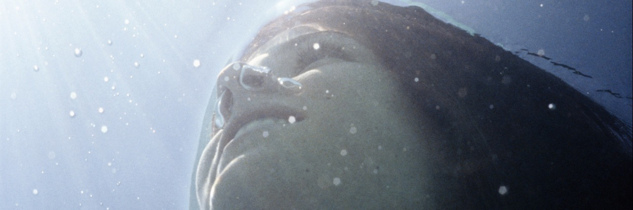 Young woman under water, low angle view