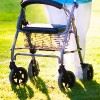 Woman using a rolling walker.