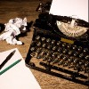 Vintage typewriter and a blank sheet of paper.