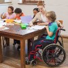 Child in a wheelchair in the classroom.