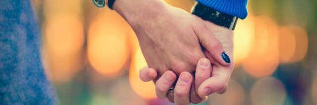 couple holding hands outdoors
