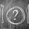 chalkboard drawing of knife, fork and plate with question mark