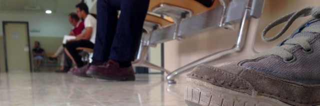 Feet of different people sitting in hospital waiting room