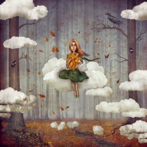 girl sits on a cloud in autumn forest. Beautiful nature background
