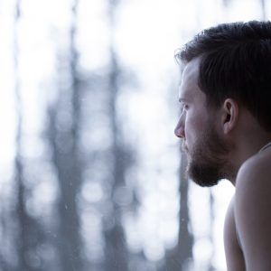 A man looking out at the woods